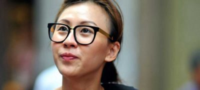 Image of Asian woman wearing glasses