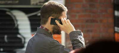 Image of man talking on mobile phone via Flickr, by Tim Parkinson